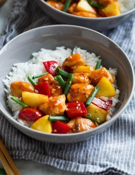 Sweet and Sour Chicken in serving bowl with white rice.