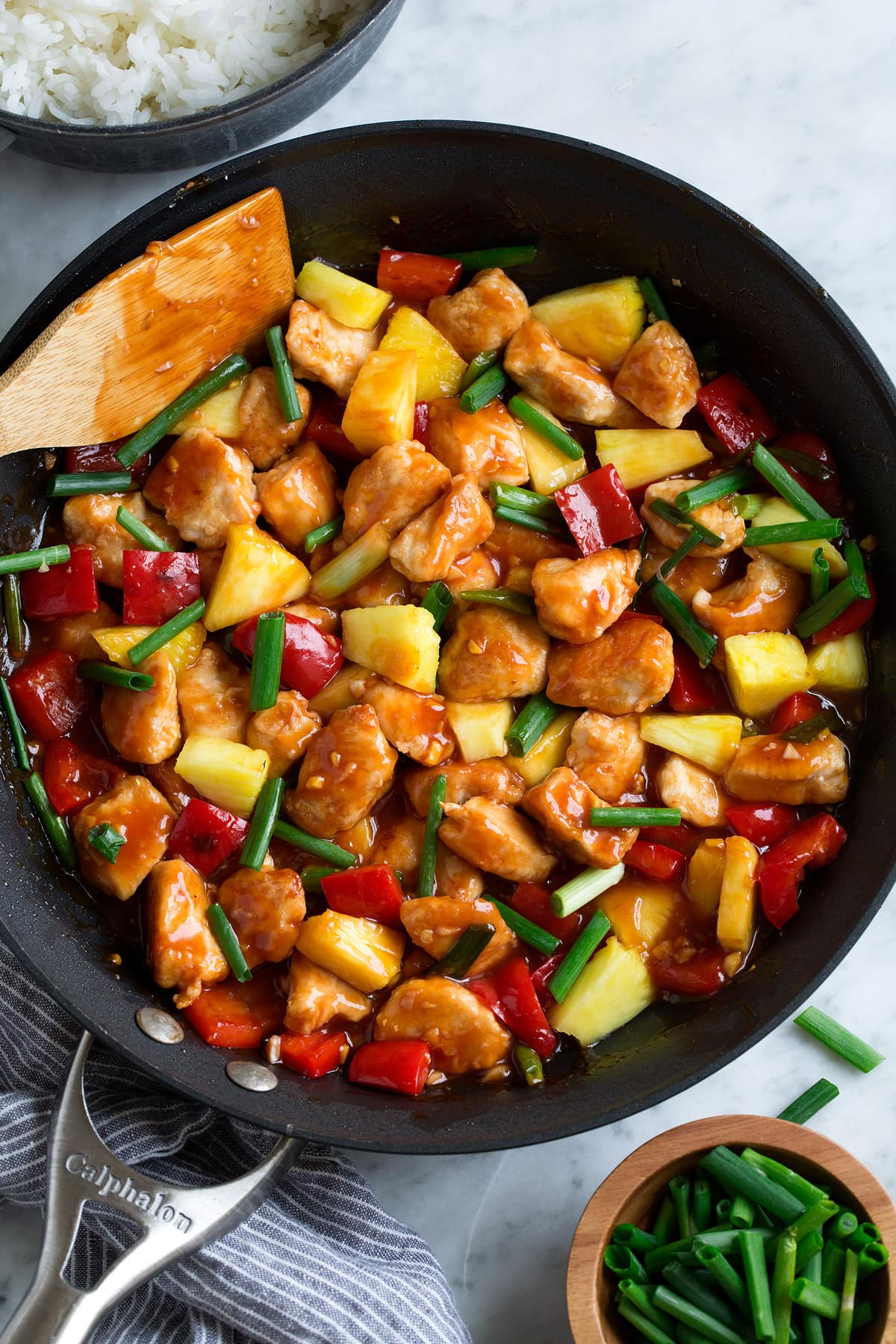 Overhead image of sweet and sour chicken in skillet.