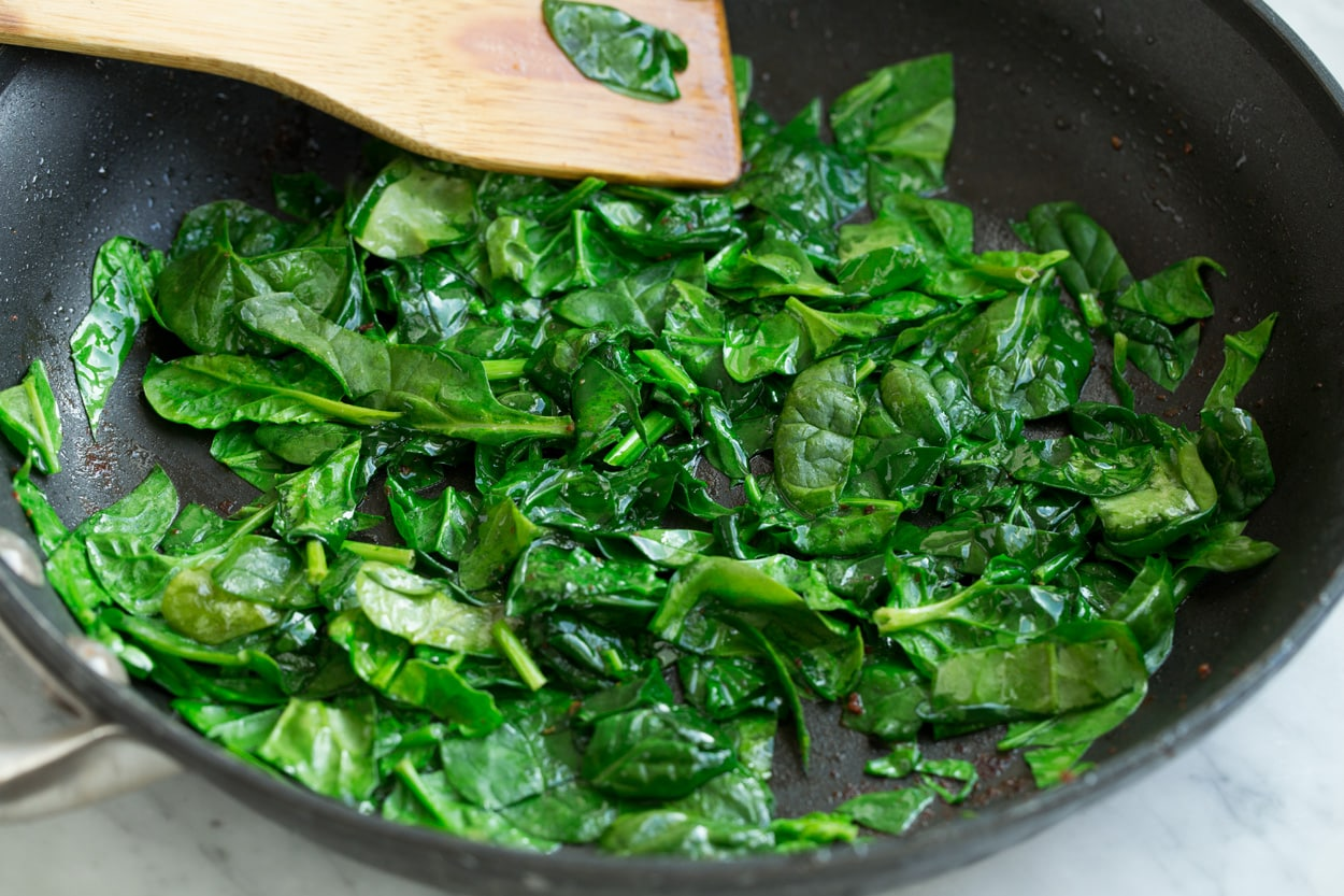 Sauteeing spinach in a large skillet to add to frittata.