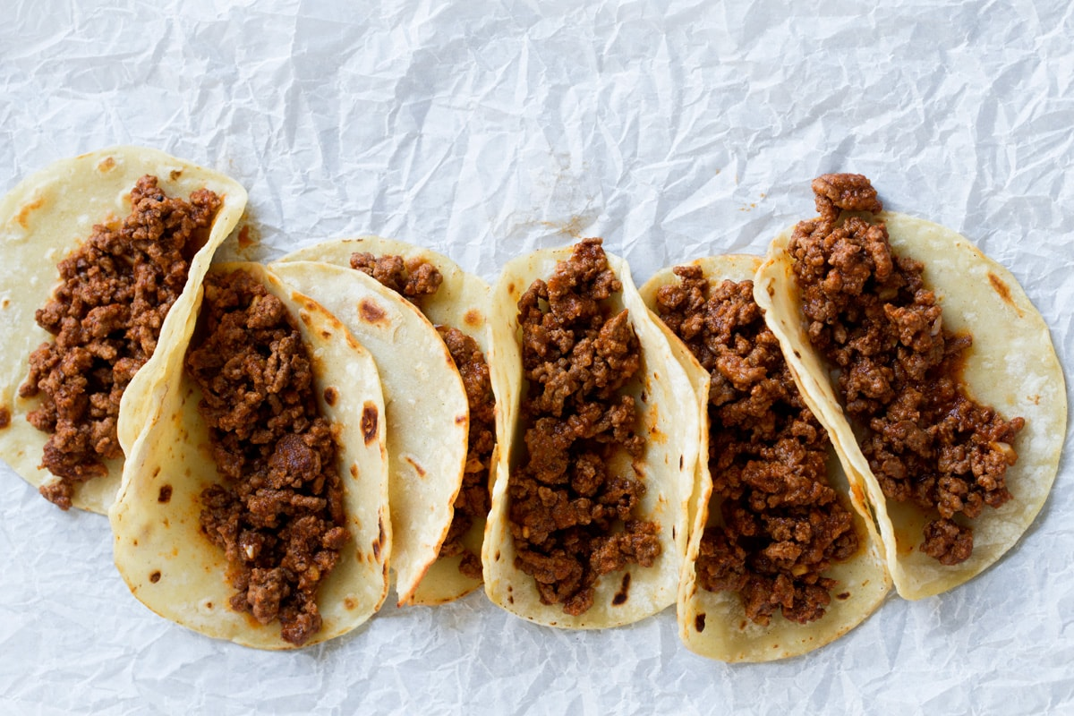 Row of tacos with taco filling.