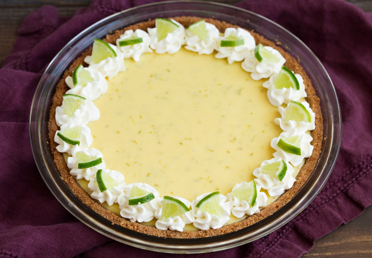 Whole key lime pie after baking, chilling and decorating.