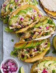 Row of salsa verde chicken tacos.