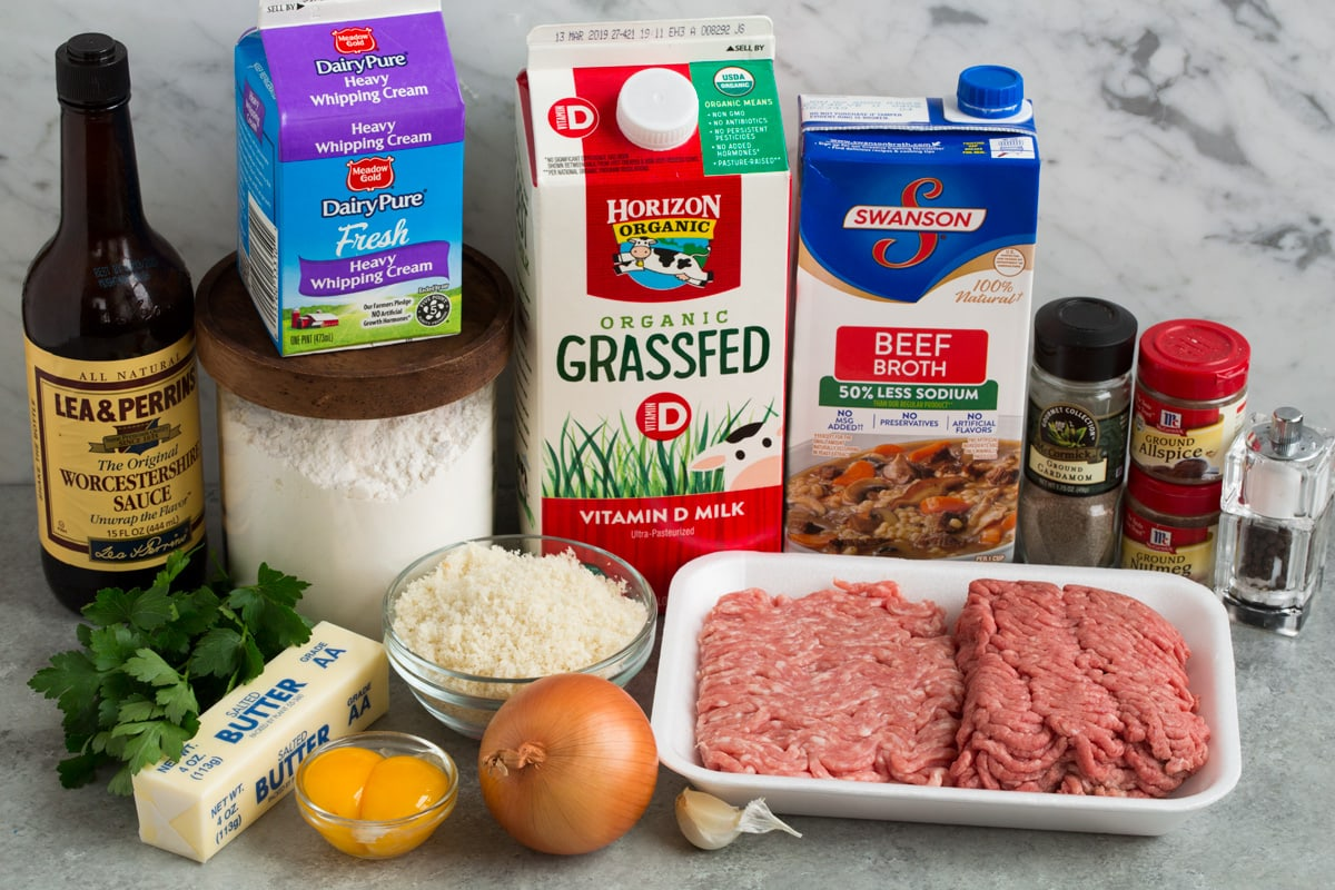 Ingredients needed for Swedish meatballs shown here including milk, fresh bread crumbs, spices, ground beef and pork, onion, garlic, butter, egg yolks, parsley, beef broth, milk, cream, flour and Worcestershire sauce.