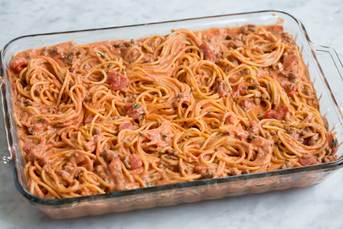 Baked spaghetti shown before baking in oven.