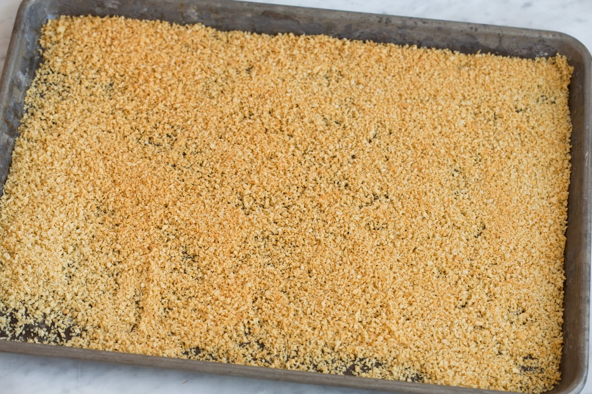 Showing how to toast panko on a baking sheet.