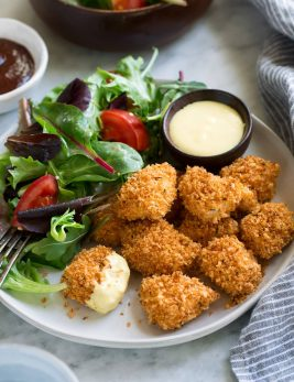 Chicken Nuggets on a serving plate with a side salad.