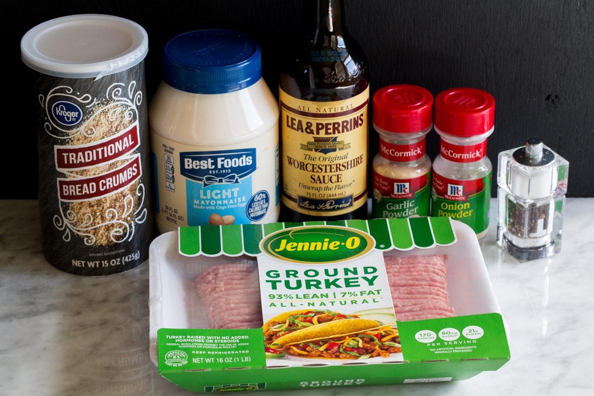 Ingredients needed to make turkey burgers shown here, including ground turkey, bread crumbs, light mayonnaise, Worcestershire, garlic powder onion powder, salt and pepper.