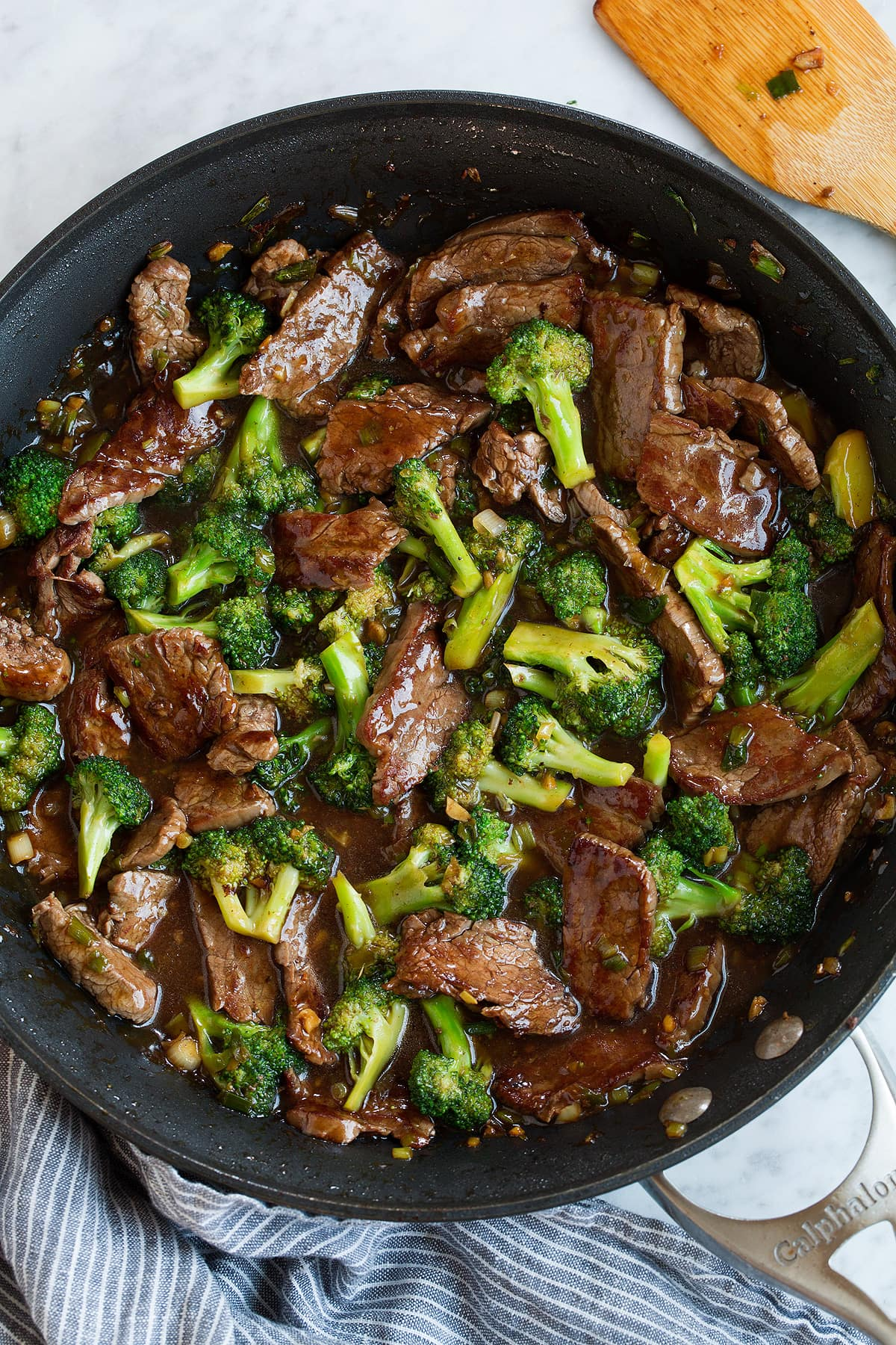 Finished beef and broccoli with sauce in a skillet.