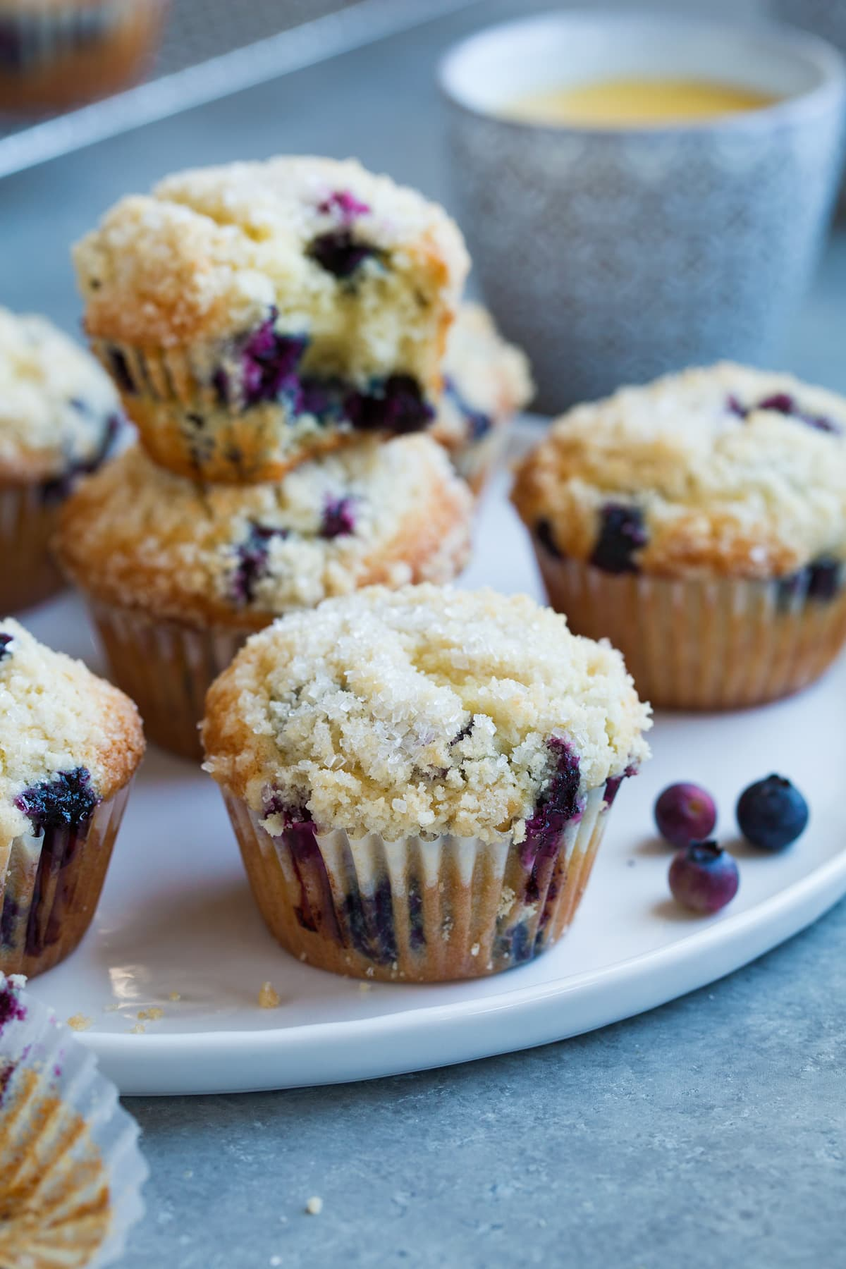 Blueberry muffins showing crumb topping.