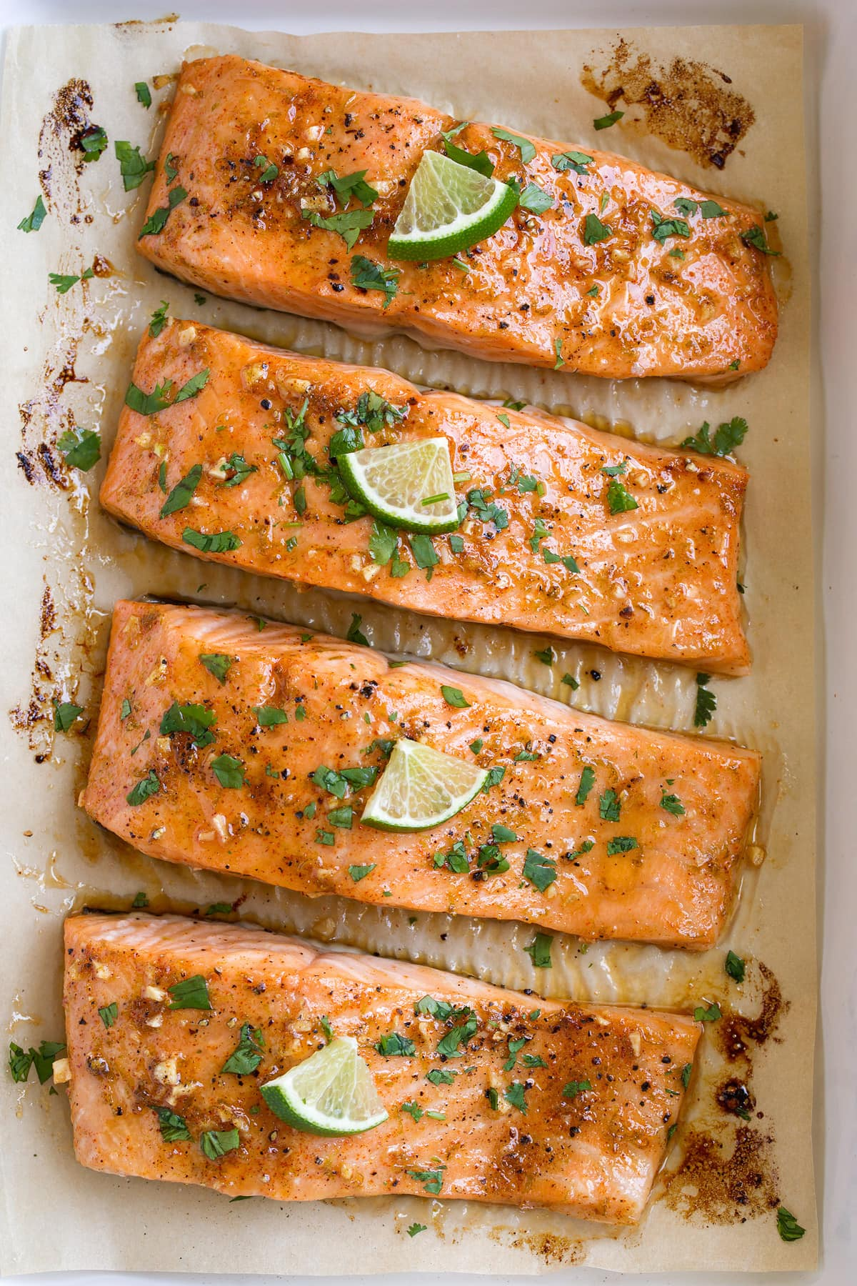 Close up overhead image of row of oven baked salmon fillets.