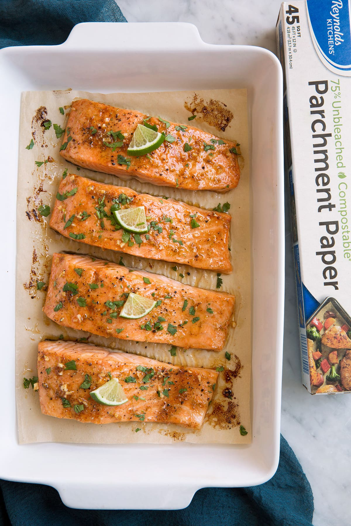 Overhead image of salmon fillets in a baking dish.