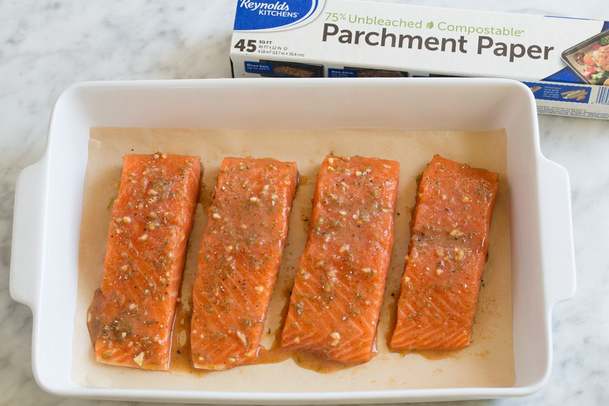 Salmon fillets in baking dish, shown before baking.