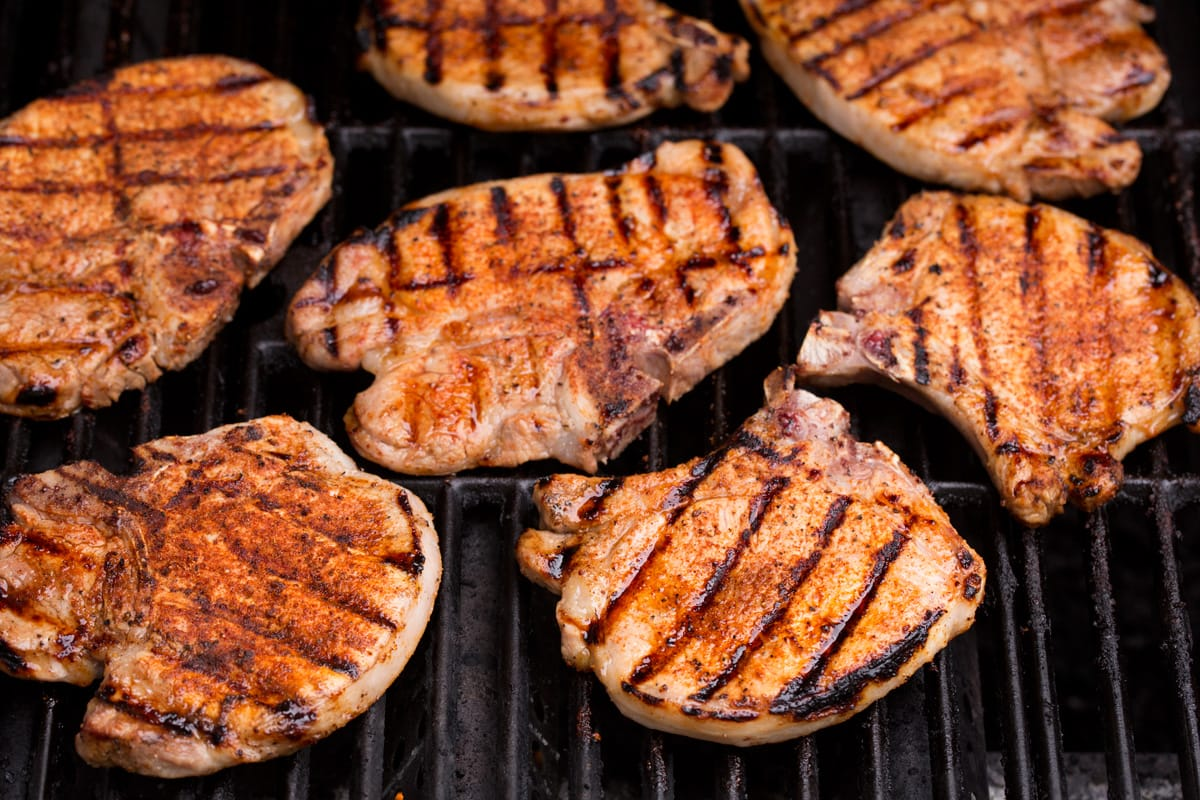 pork chops on a grill shown after finished cooking