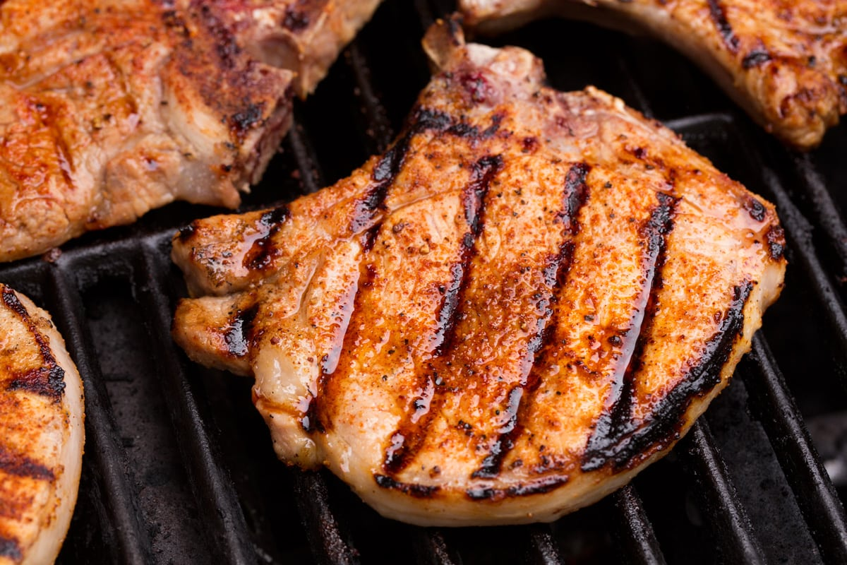 Close up image of pork chop on grill.