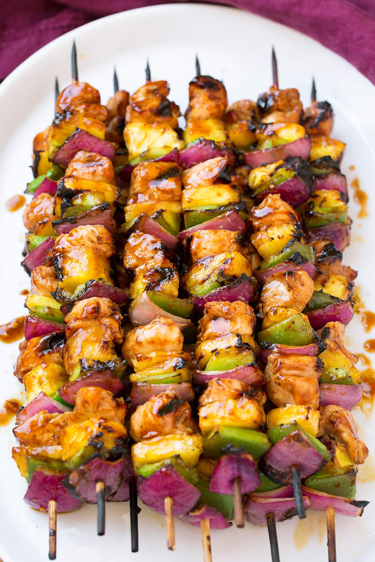 Grilled Hawaiian Chicken Kebabs on a white platter.