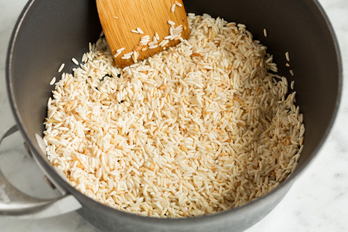 Sautéing rice in a saucepan.