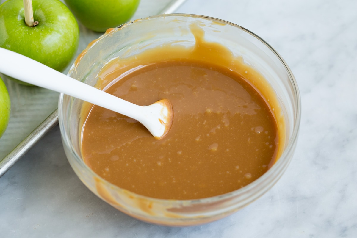 melted caramel in a glass mixing bowl.