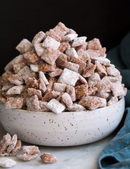 Bowl mounded full of puppy chow muddy buddies.