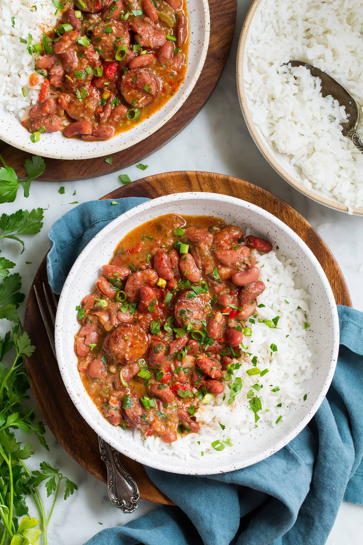 two servings of red beans and rice in bowls