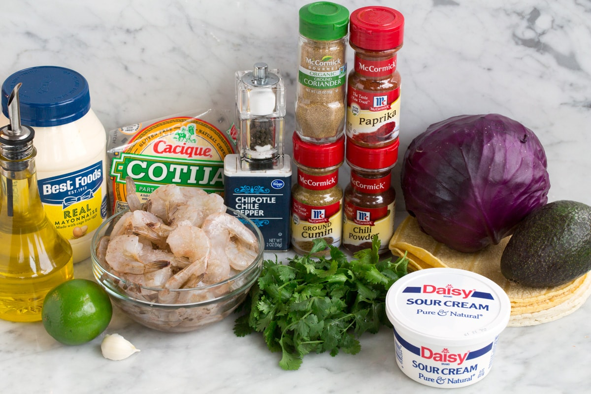 Ingredients needed to make shrimp tacos.