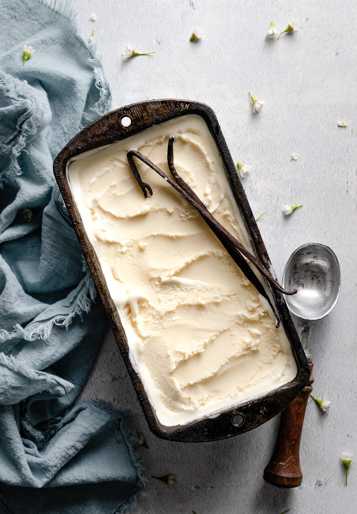 Easy vanilla ice cream recipe shown frozen in a loaf pan.