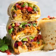 Stack of breakfast burritos.