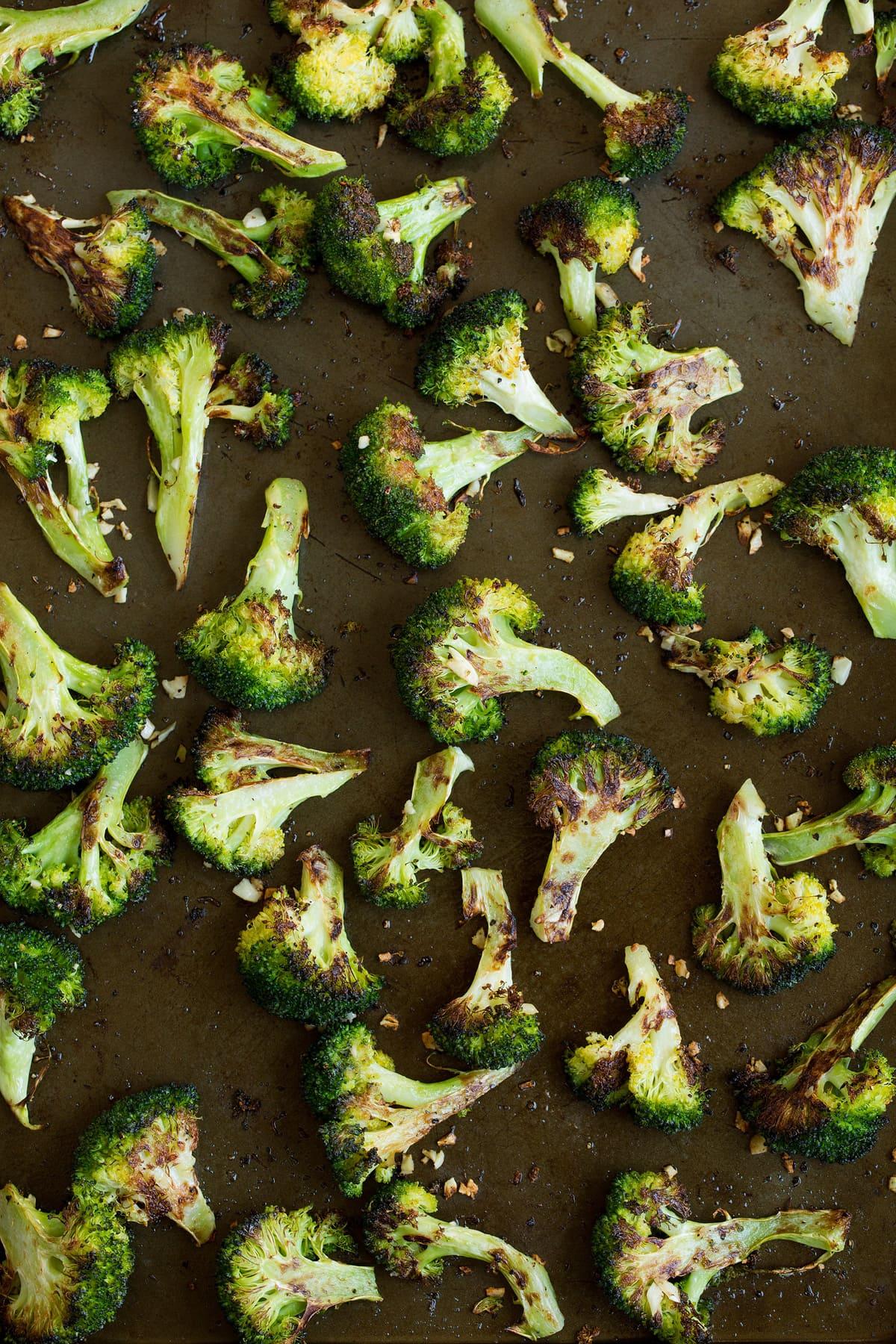 Roasted broccoli florets after baking.