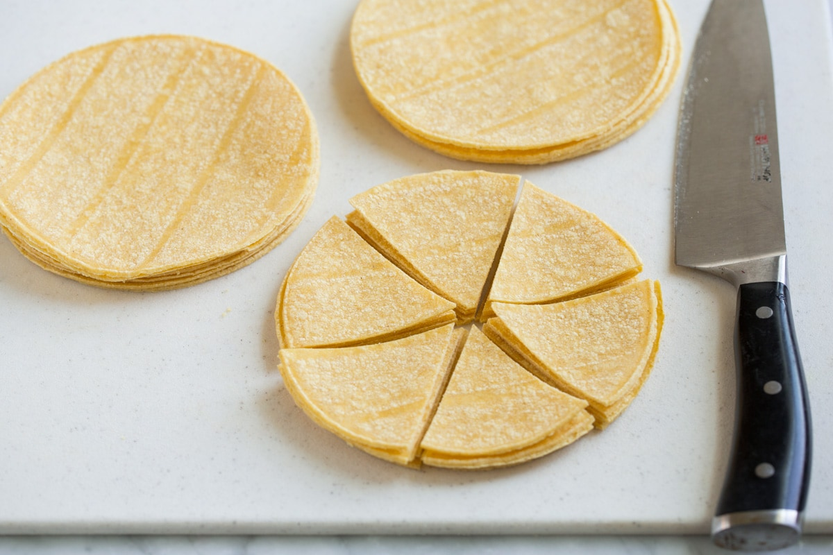 Cutting tortilla stacks into wedges.