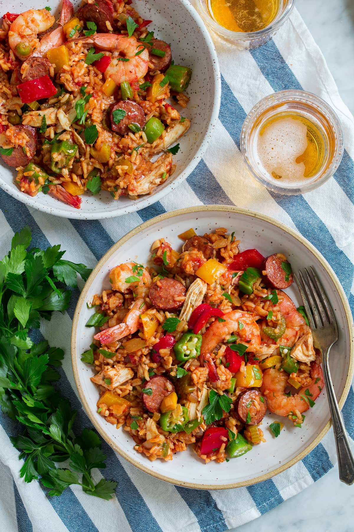 Two servings of jambalaya in bowls.