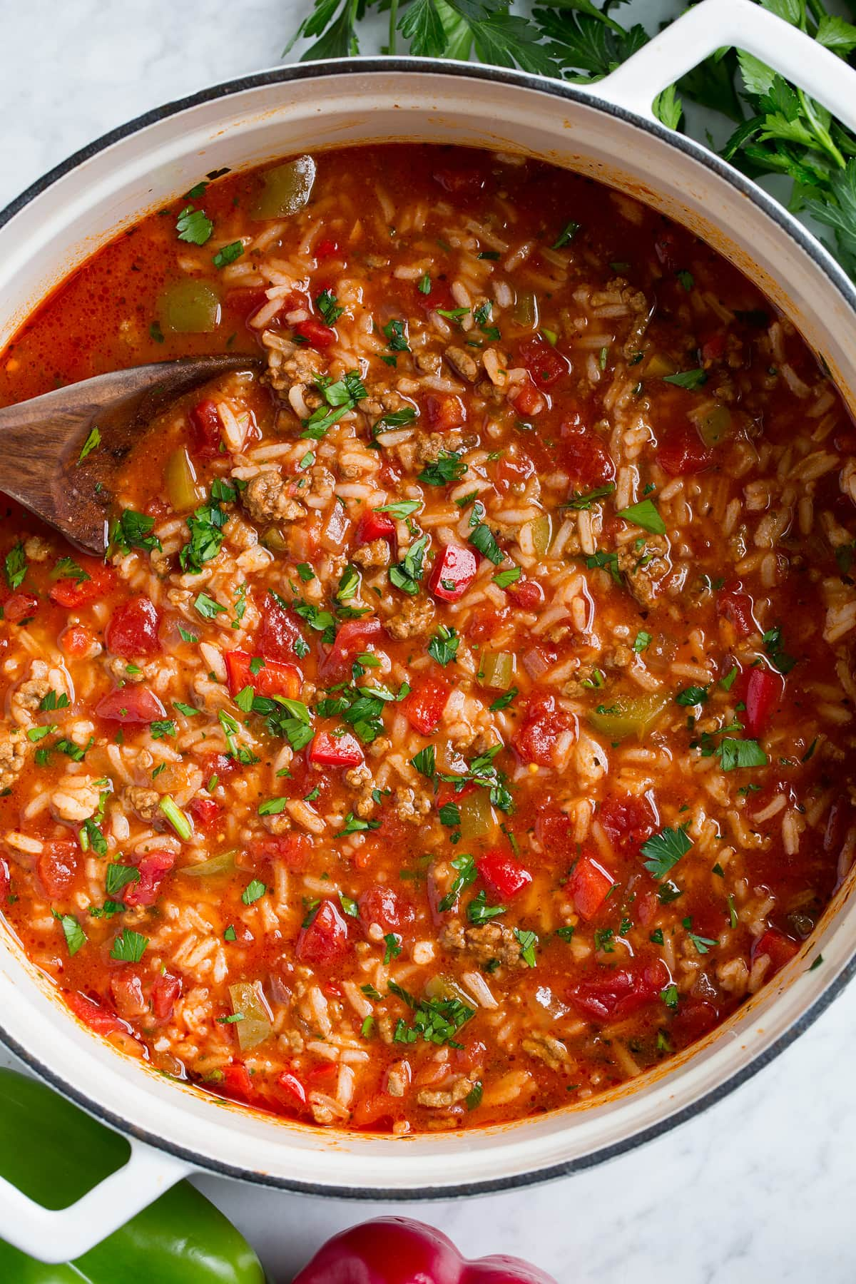 Overhead image of stuffed bell pepper soup in a large pot.