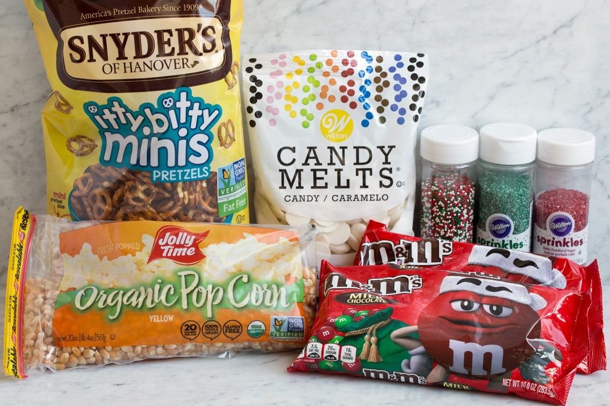 Ingredients to make easy christmas crunch popcorn treat.