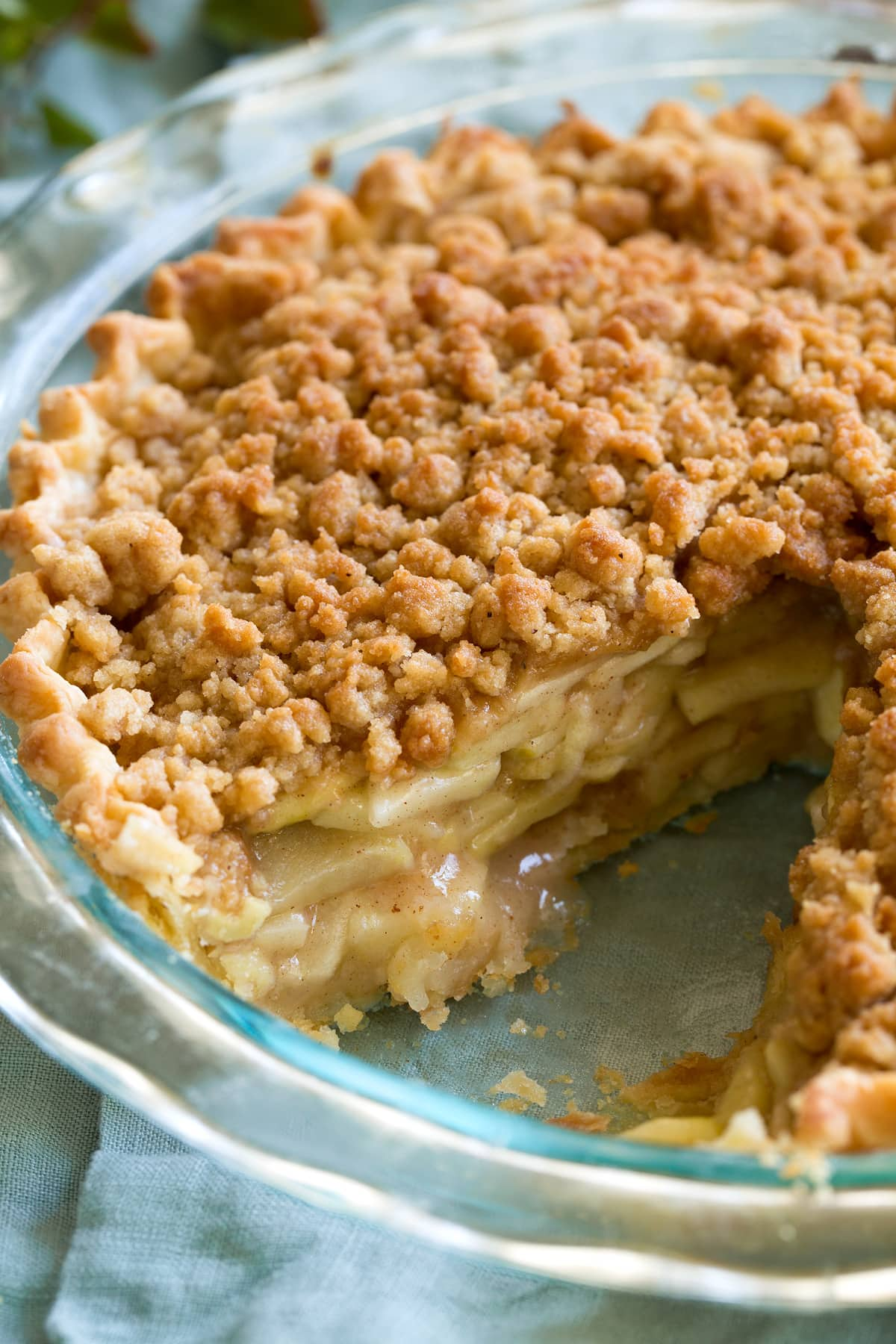 Close up image of Dutch apple pie in a glass pie pan.