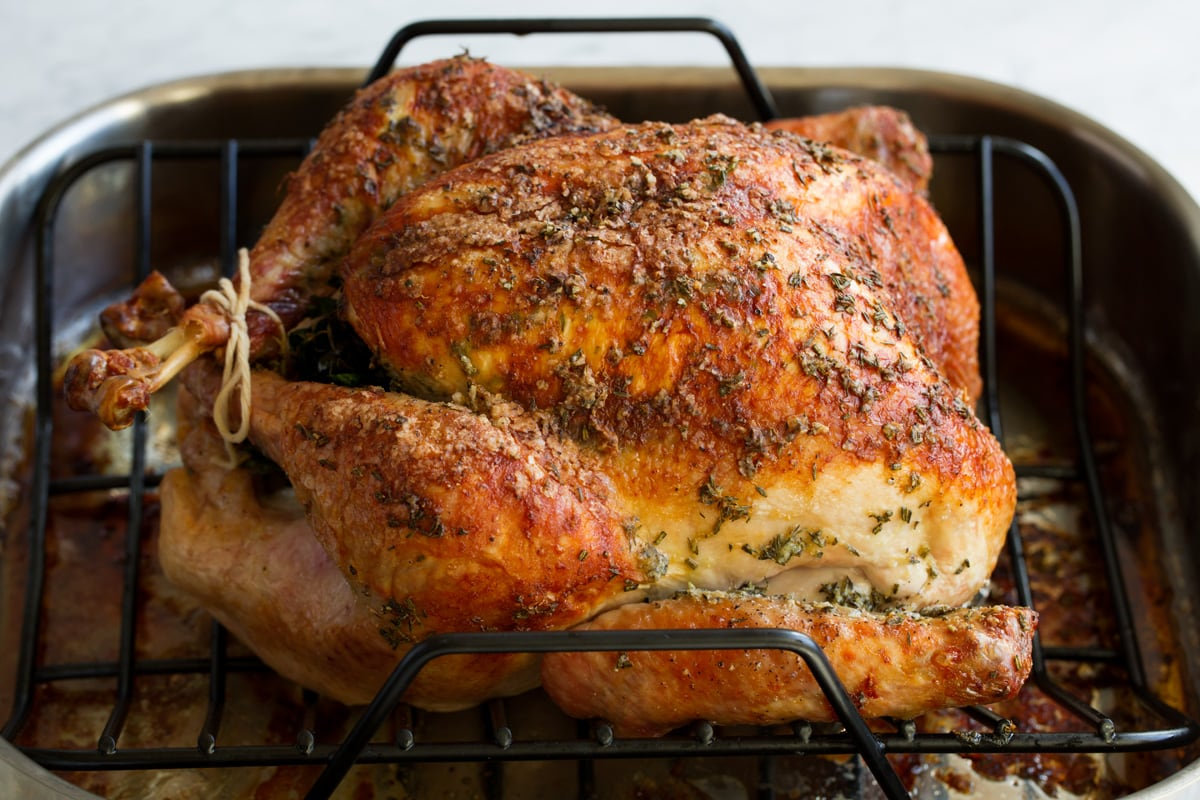 Baked turkey in a roasting pan.