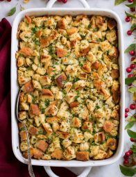 Stuffing in a white casserole dish.