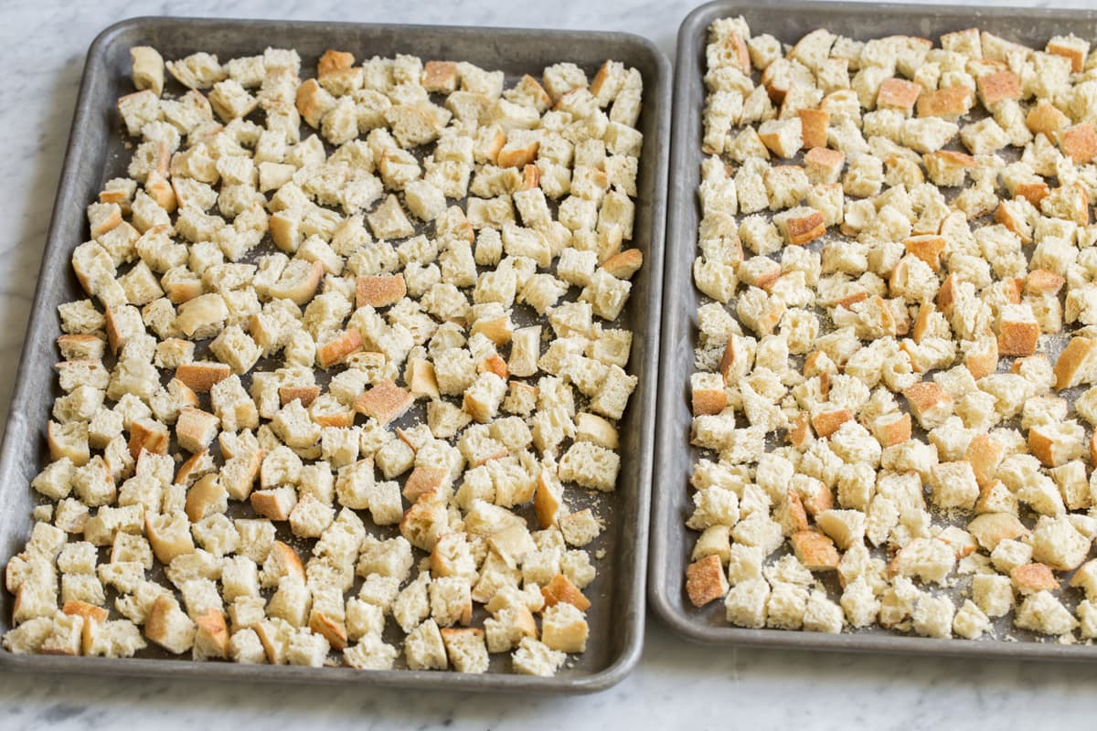 Bread cubes on a baking dish after drying in the oven.