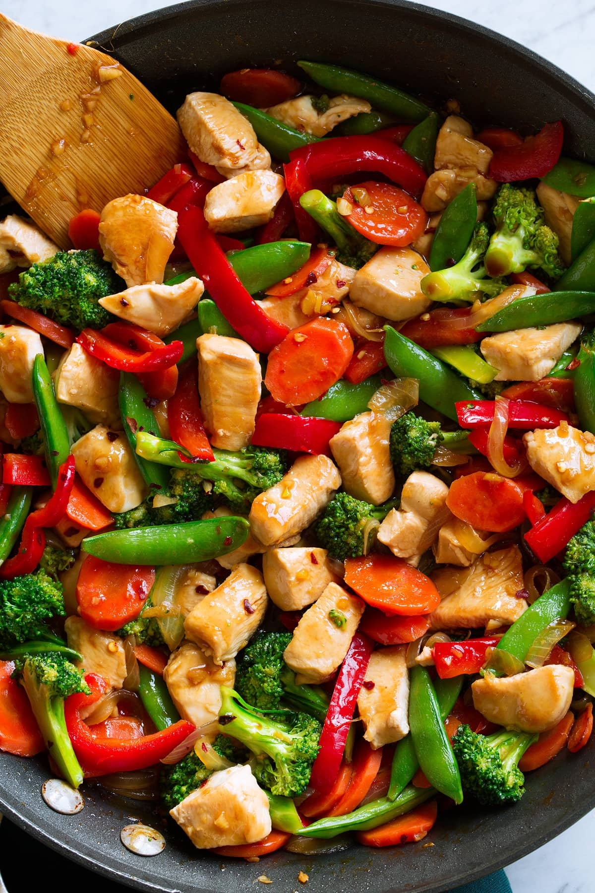 Healthy chicken stir fry in a pan.