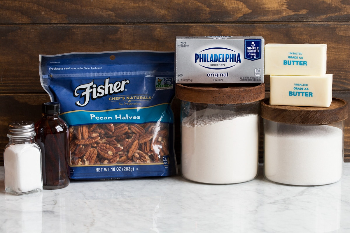 Image showing ingredients that go into cream cheese pecan cookies.