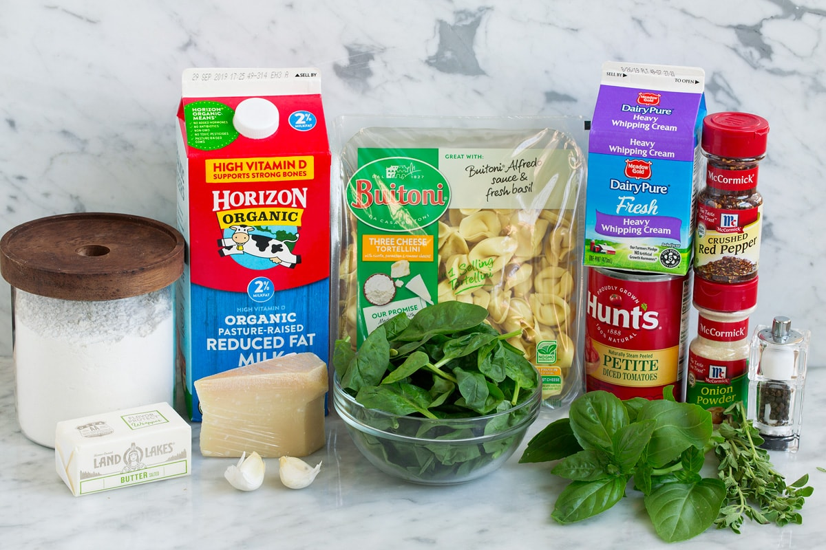 Image of ingredients that go into spinach and tomato tortellini.