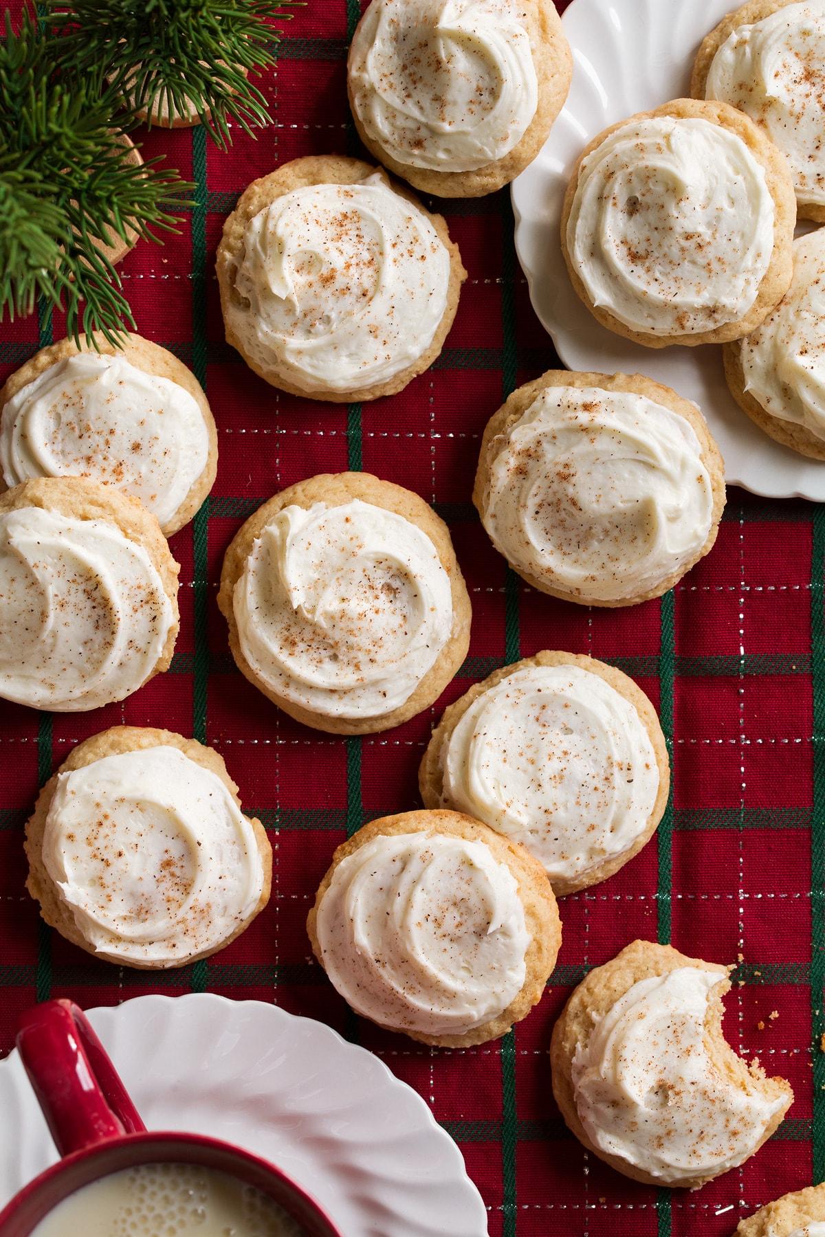 Eggnog Cookies sitting on a Christmas plaid tablecloth.