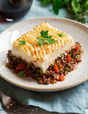 Cut serving of shepherd's pie on a serving plate.