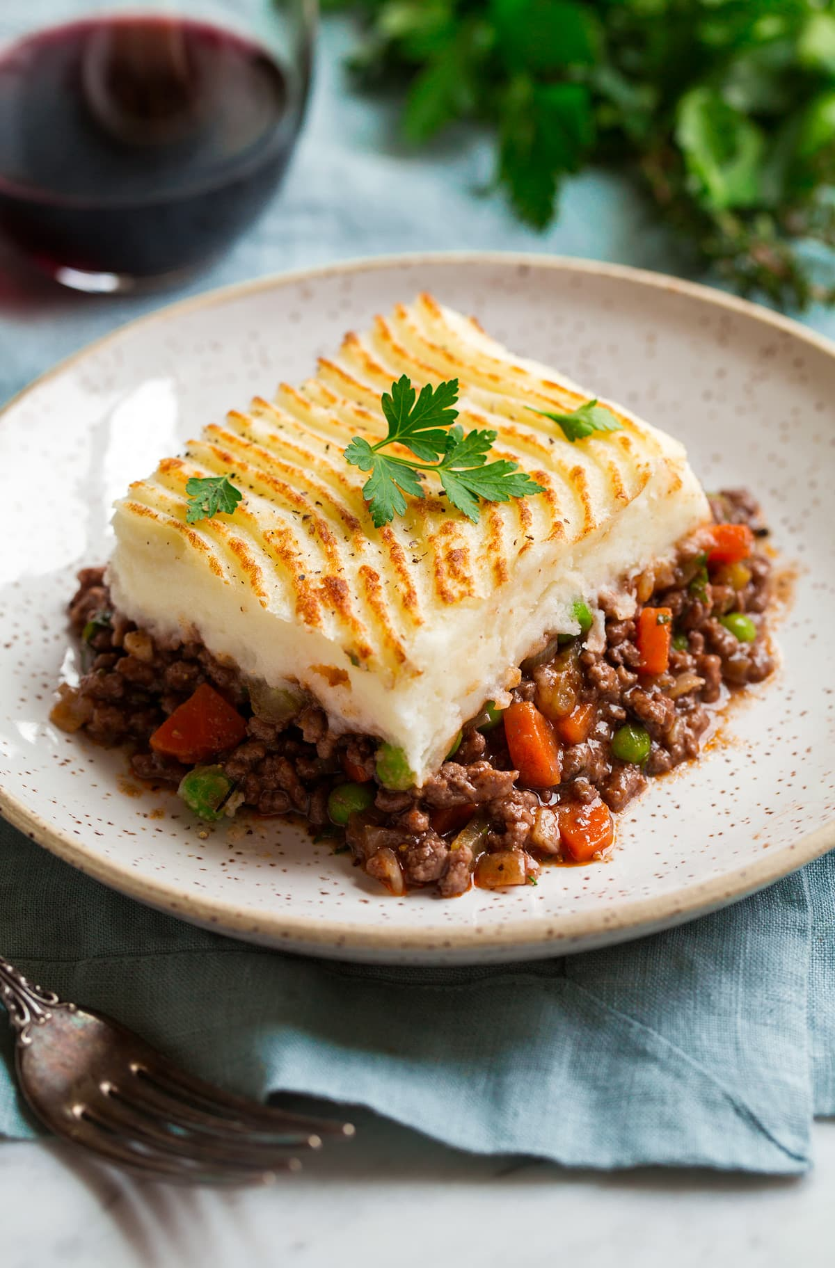 Cut serving of shepherd's pie on a serving plate.