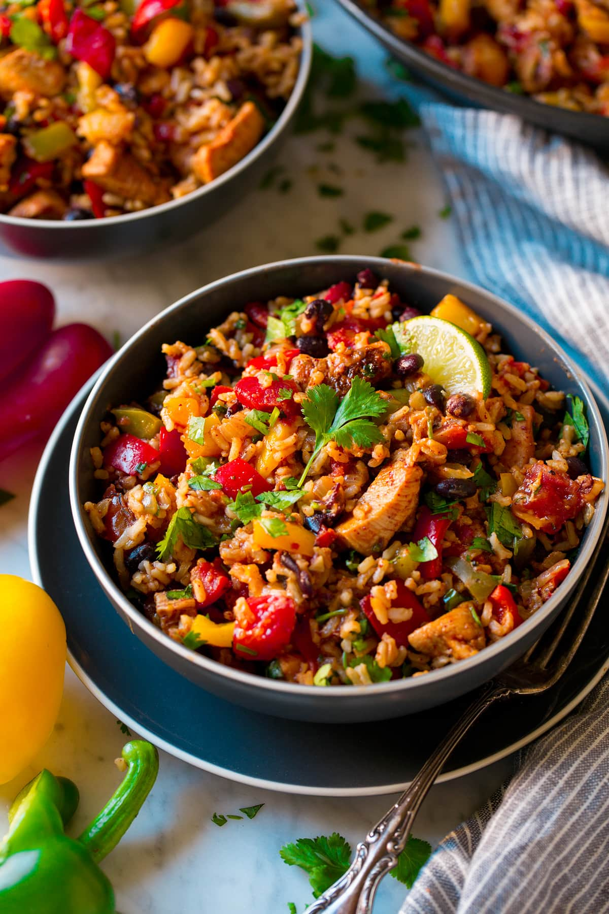 Chicken Fajita Rice Bowl shown as two servings in dark blue bowls.