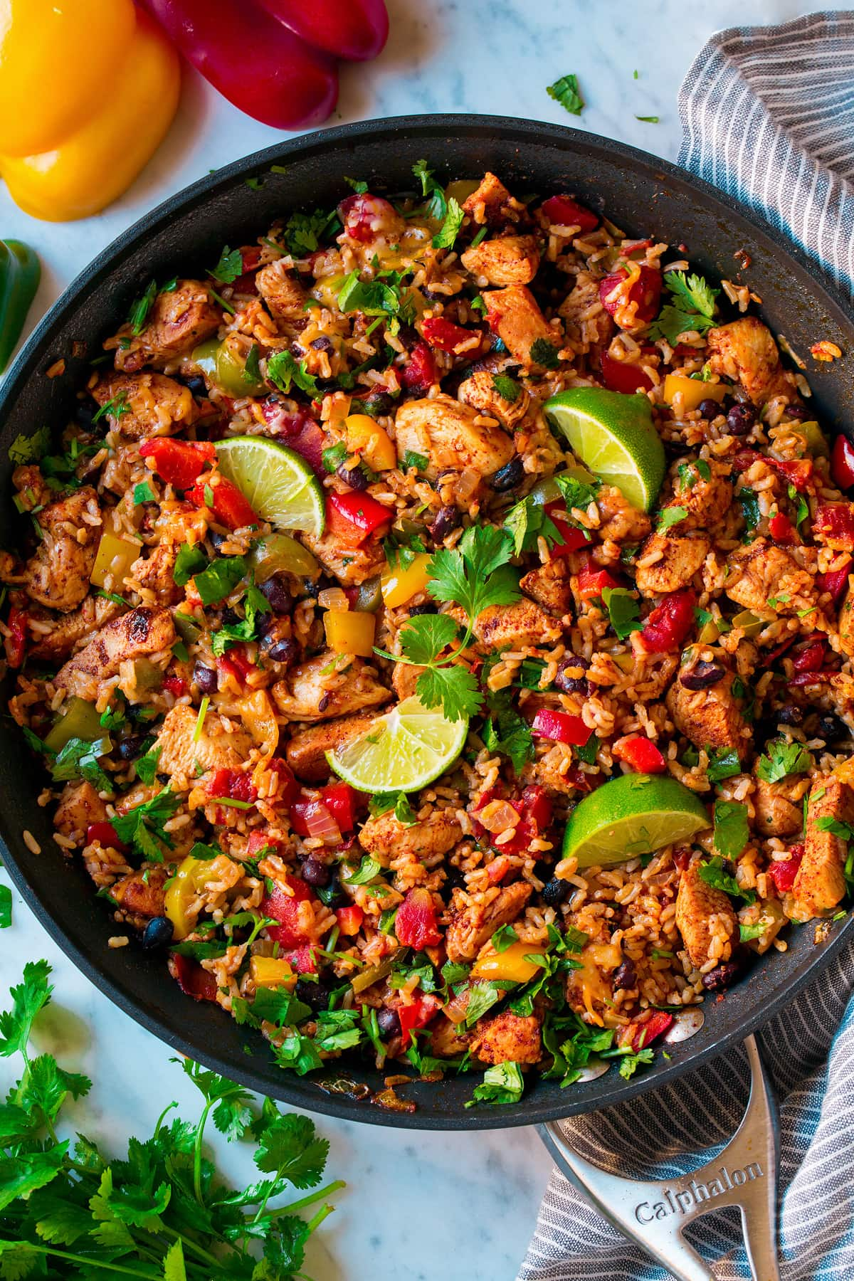 Chicken Fajita Rice Bowl shown after cooking in one pan. It includes brown rice, chicken, black beans and bell peppers.