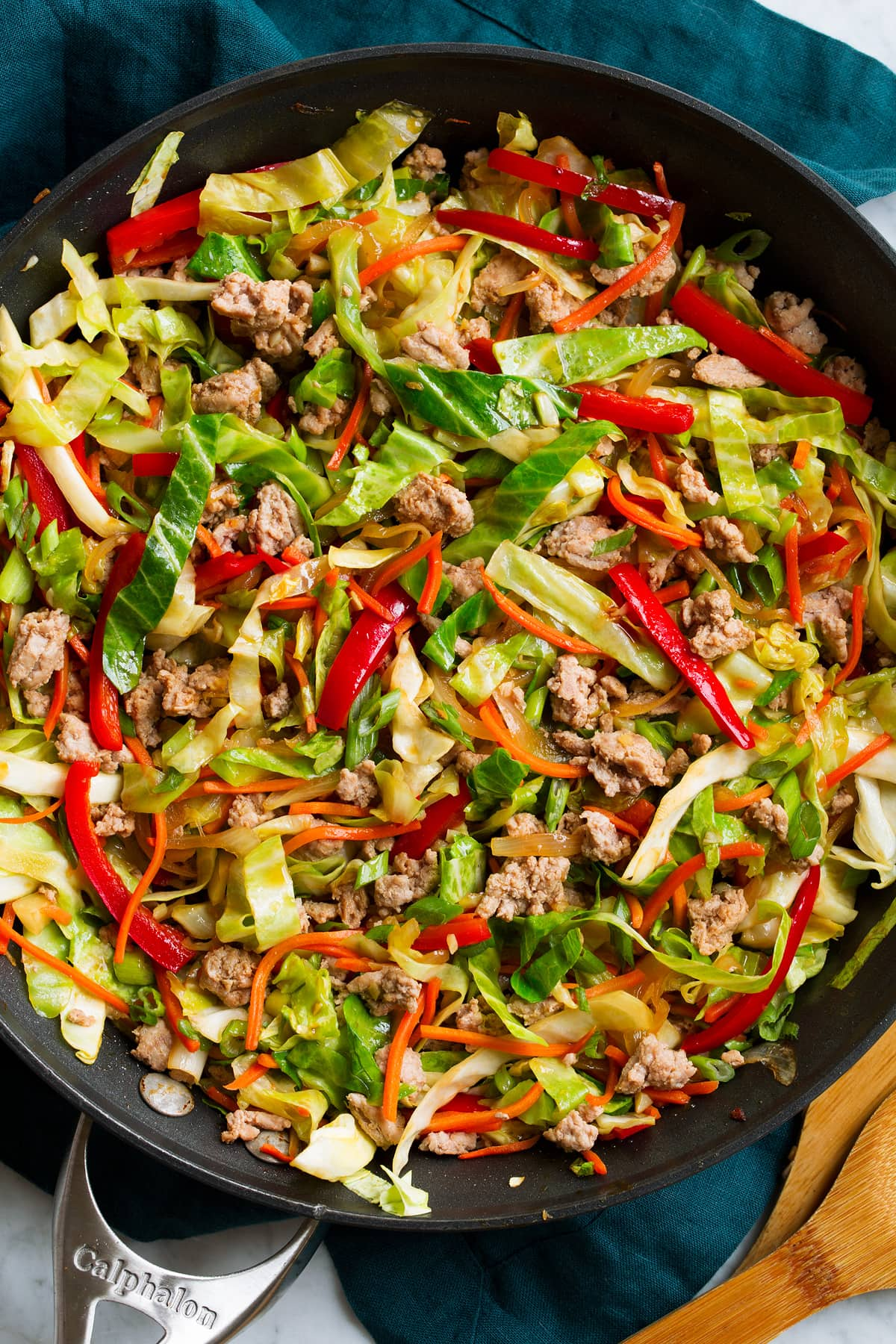Close up image of egg roll in a bowl in a skillet.