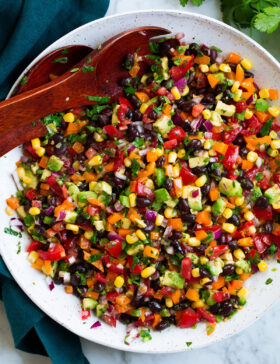Black bean and corn salad with bell pepper, avocado, tomato and cilantro lime dressing.