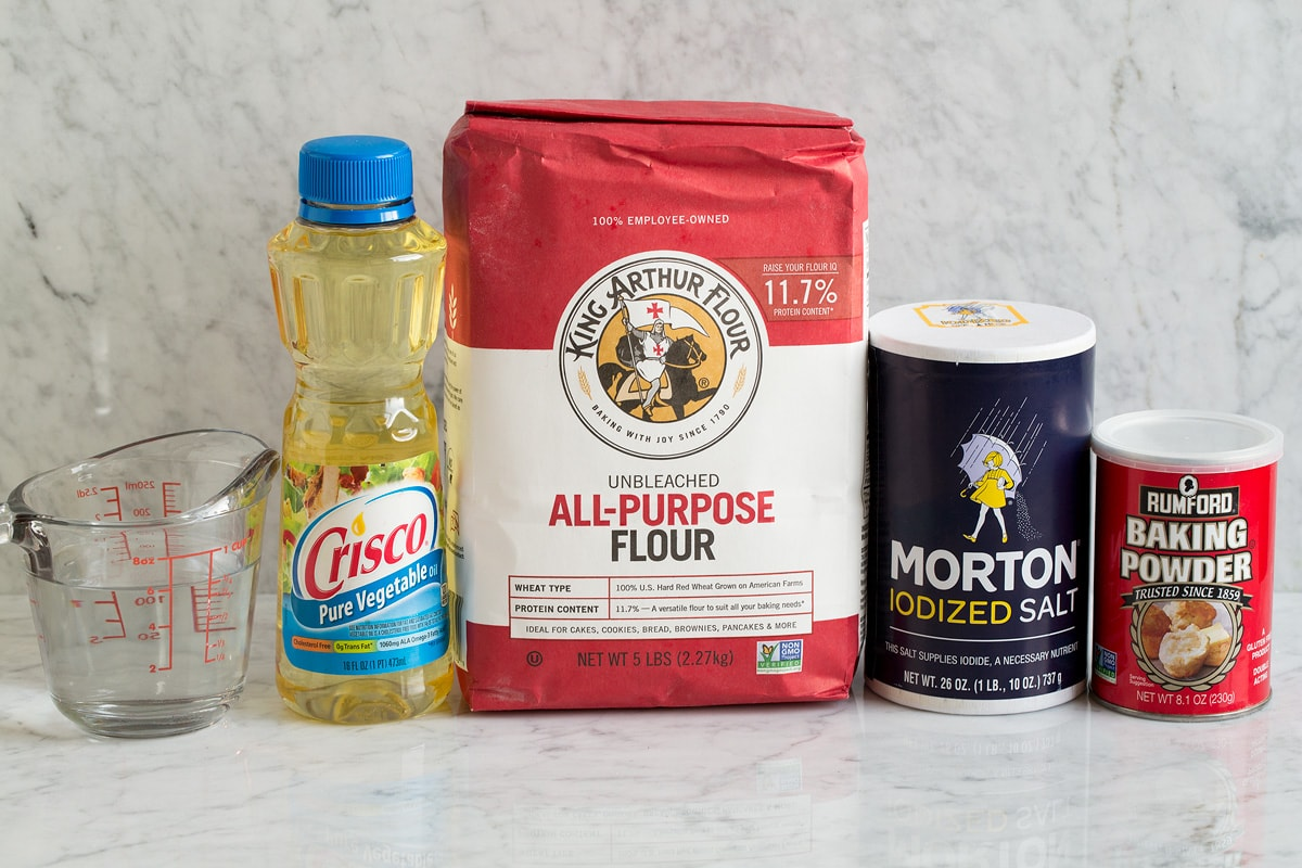 5 Ingredients needed to make flour tortillas from scratch shown here.