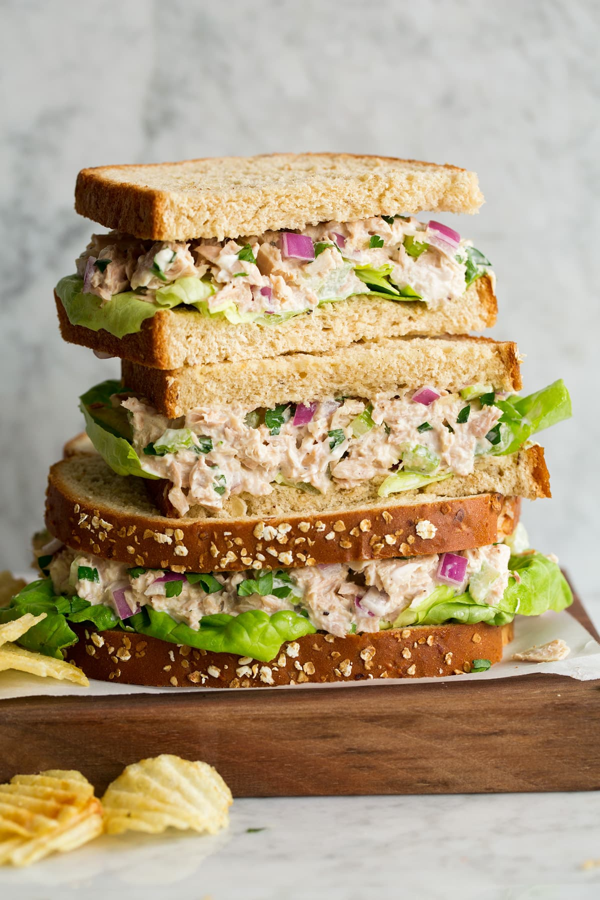 Stack of tuna salad sandwiches.