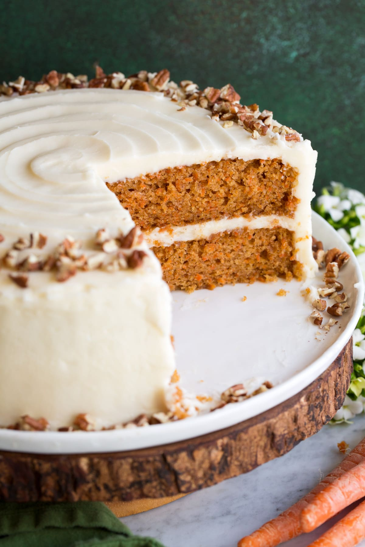 Close up image of carrot cake, sliced into to show interior.