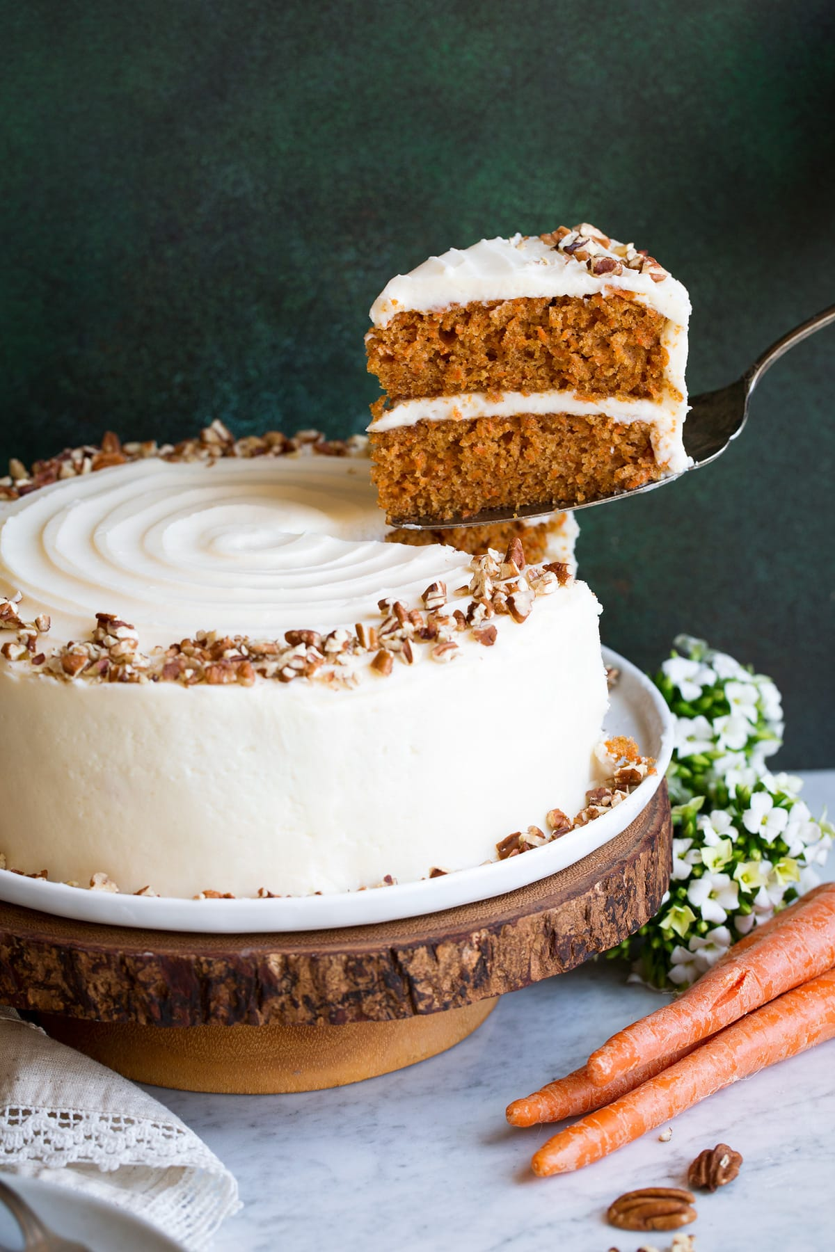 Carrot Cake with one slice being removed.