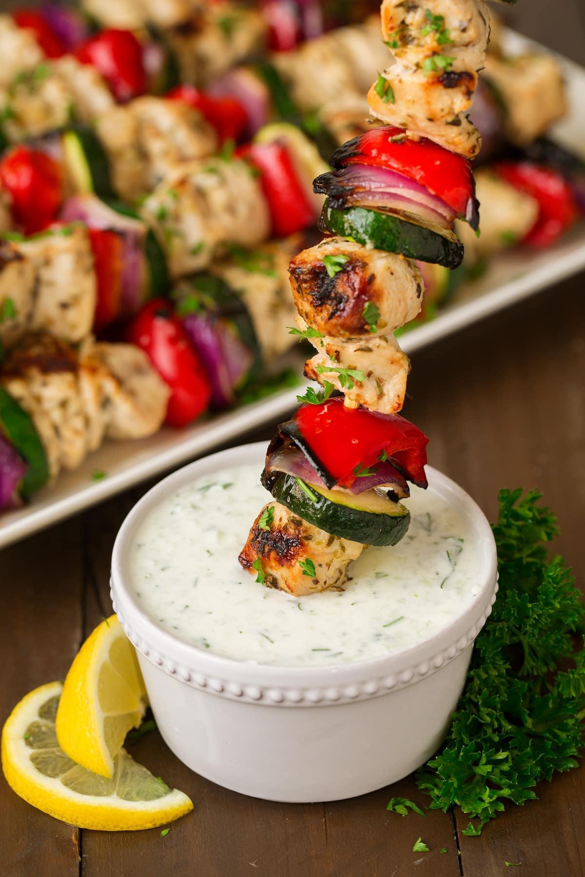 Greek Chicken Kebabs dipped in tzatziki sauce